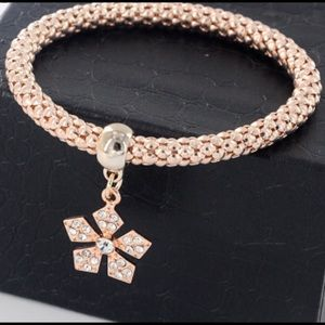 Rose gold tone crystal flower bracelet